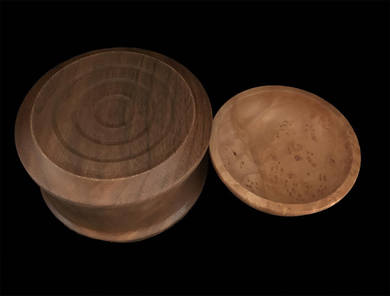 walnut box with birds eye maple lid and walnut finial